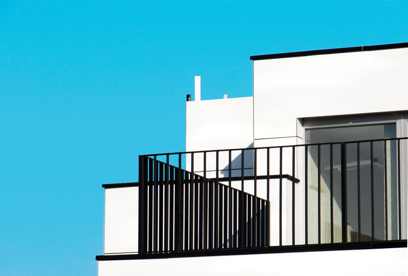 white-building-angainst-blue-sky
